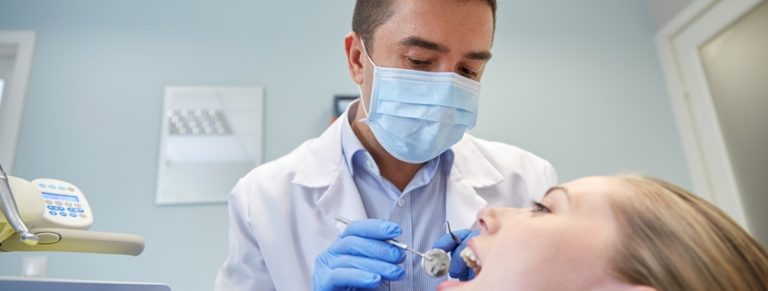 dental specialist examining teeth